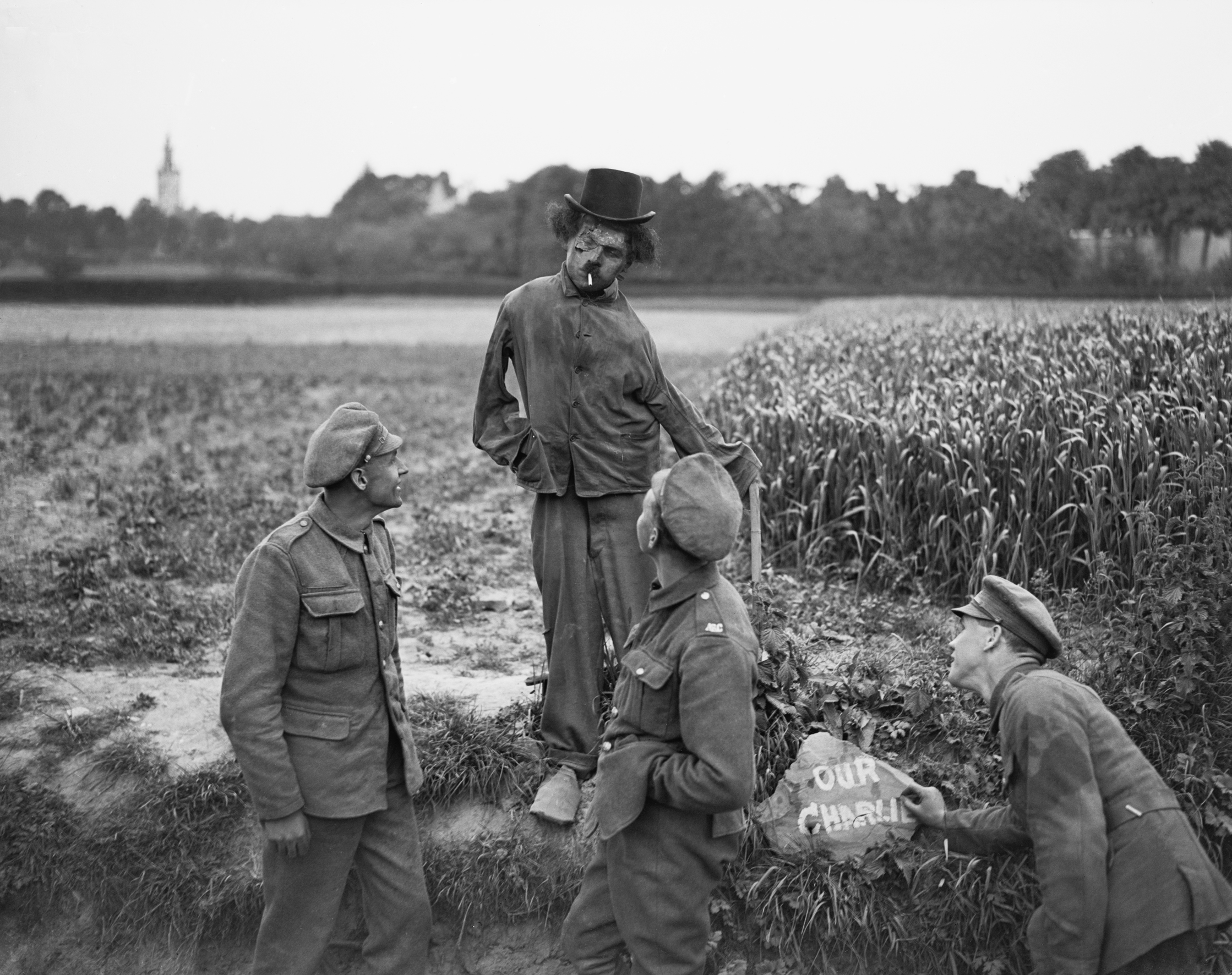 Figure representing Charlie Chaplin set up by the roadside at Watten by men of the A.S.C., M.T. Copyright IWM.