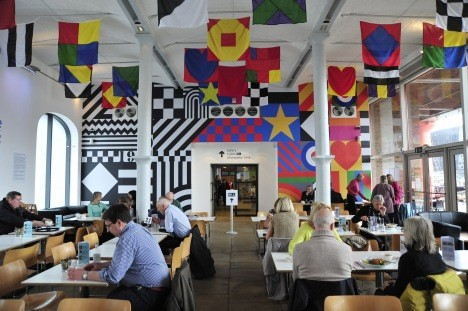 Tate Liverpool's new café with wall motif and flags designed by Sir Peter Blake