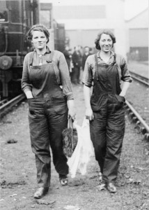 Female carriage cleaners on the London and South Western Railway, carrying their materials.