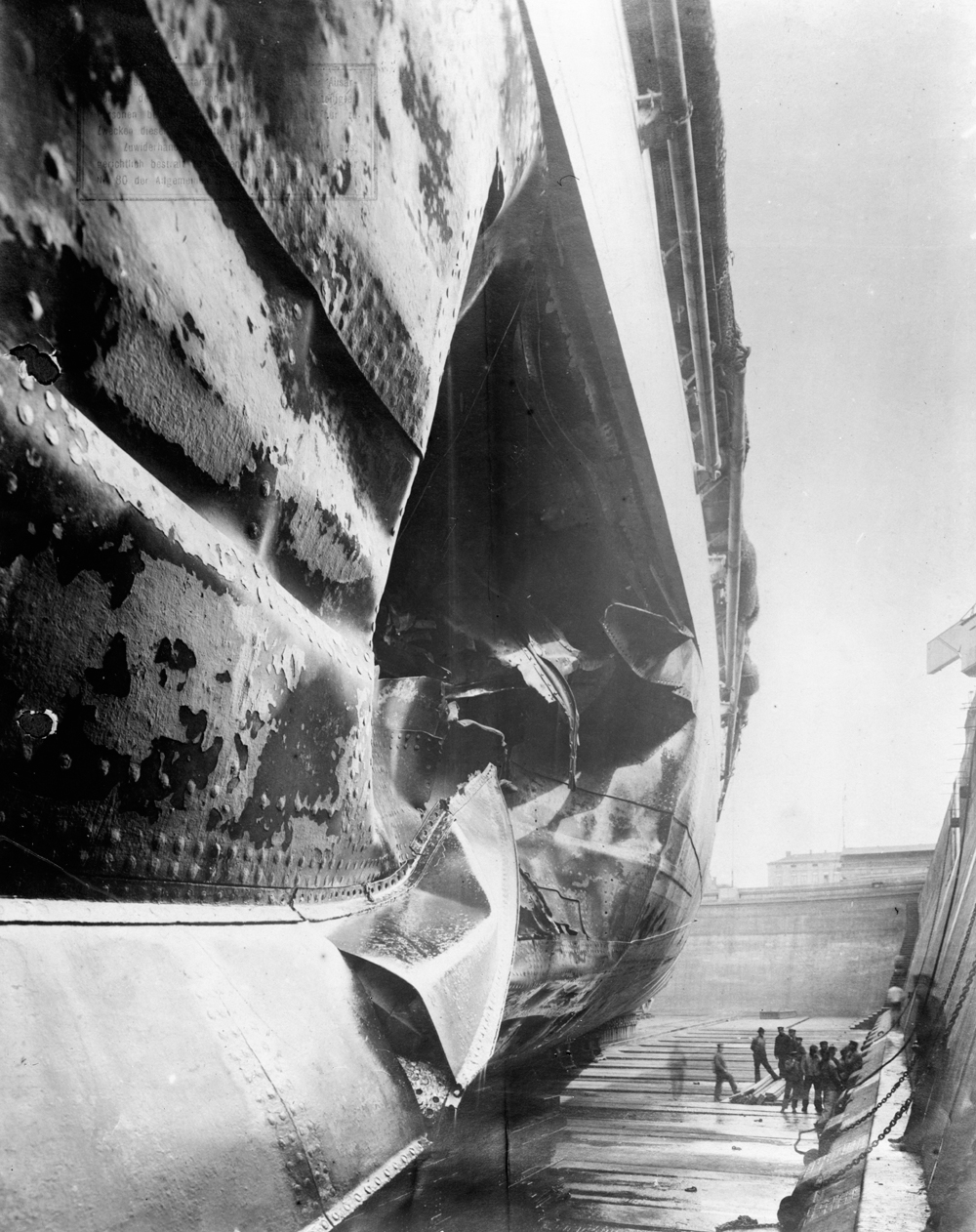 A very large hole in the starboard side of the German battleship Ostfriesland sustained the day after the Battle of Jutland when she hit a mine, photographed in dry dock.