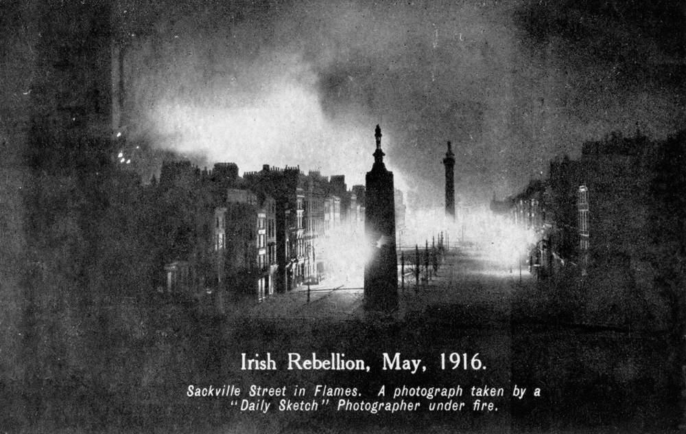Burning buildings in Sackville Street, Dublin (subsequently renamed O'Connell Street) which sustained severe damage during the Easter Rising. The General Post Office had been seized by Irish republicans. British forces bombarded it and set it on fire, forcing the republicans to relocate to Moore Street.