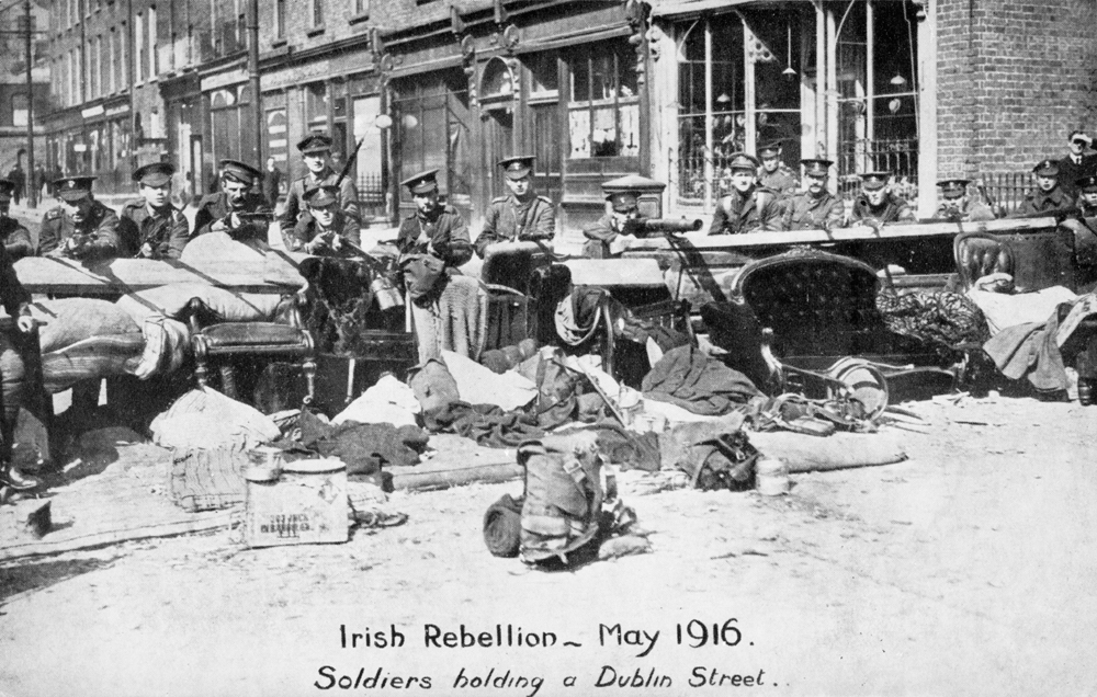 British troops man a street barricade in Dublin.