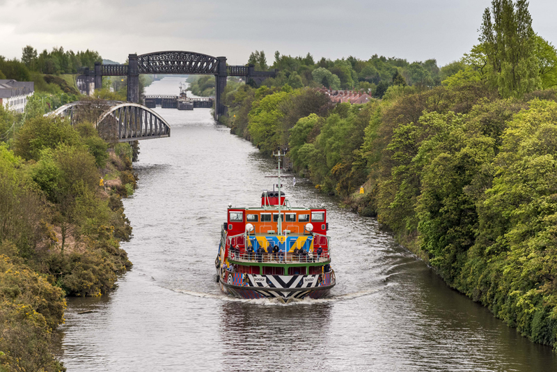 Dazzle Ferry Manchester Ship Canal, Everybody Razzle Dazzle, Sir Peter Blake, 2015. Image credit - Mersey Ferries